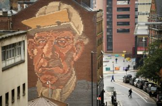 "The ""Steelworker"" Brick Mural by Paul Waplington, representing the past industrial boom, is pictured in central Sheffield, south Yorkshire on October 21, 2020, prior to further lockdown measures as the number of novel coronavirus COVID-19 cases rises. - More than a million people in northern England will be banned from mixing with other households under tougher new coronavirus rules announced by government minister Robert Jenrick on Wednesday.  The county of South Yorkshire, which includes the city of Sheffield, will enter into ""very high alert"" restrictions from 12.01am on Saturday (2301 Friday GMT). (Photo by Oli SCARFF / AFP) / RESTRICTED TO EDITORIAL USE - MANDATORY MENTION OF THE ARTIST UPON PUBLICATION - TO ILLUSTRATE THE EVENT AS SPECIFIED IN THE CAPTION"