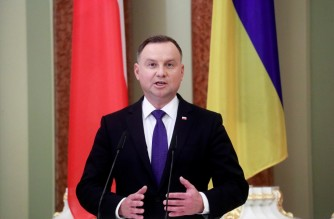 (FILES) In this file photo taken on October 12, 2020, Polish President Andrzej Duda holds a joint news briefing with his Ukrainian counterpart as part of their meeting in Kiev. - Poland's President Andrzej Duda has tested positive for coronavirus, an aide said on October 24, 2020, as the country faces a record rise in cases. (Photo by VALENTYN OGIRENKO / POOL / AFP)
