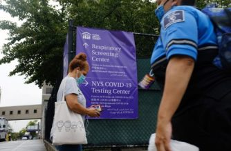 NEW YORK, NEW YORK - AUGUST 13: A sign directs people where to take a Covid-19 test in the Sunset Park neighborhood which has seen a spike in coronavirus cases in recent days on August 13, 2020 in New York City. City officials have sent numerous teams to the neighborhood, which has a large number of Latino and Asian residents, for both testing and to provide outreach to the community. New York Mayor Bill de Blasio announced on Wednesday that 228 people have tested positive for COVID-19 in the past two weeks.   Spencer Platt/Getty Images/AFP