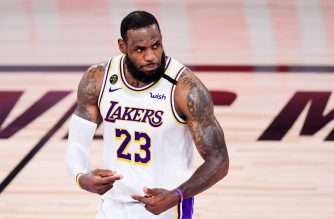 LAKE BUENA VISTA, FLORIDA - OCTOBER 11: LeBron James #23 of the Los Angeles Lakers reacts during the second quarter against the Miami Heat in Game Six of the 2020 NBA Finals at AdventHealth Arena at the ESPN Wide World Of Sports Complex on October 11, 2020 in Lake Buena Vista, Florida. NOTE TO USER: User expressly acknowledges and agrees that, by downloading and or using this photograph, User is consenting to the terms and conditions of the Getty Images License Agreement.   Douglas P. DeFelice/Getty Images/AFP