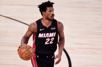 LAKE BUENA VISTA, FLORIDA - OCTOBER 11: Jimmy Butler #22 of the Miami Heat controls the ball against the Los Angeles Lakers in the third quarter of Game Six of the 2020 NBA Finals at AdventHealth Arena at the ESPN Wide World Of Sports Complex on October 11, 2020 in Lake Buena Vista, Florida. NOTE TO USER: User expressly acknowledges and agrees that, by downloading and or using this photograph, User is consenting to the terms and conditions of the Getty Images License Agreement.   Douglas P. DeFelice/Getty Images/AFP