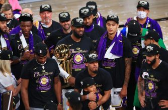 LAKE BUENA VISTA, FLORIDA - OCTOBER 11: The Los Angeles Lakers celebrate with the trophy after winning the 2020 NBA Championship Final over the Miami Heat in Game Six of the 2020 NBA Finals at AdventHealth Arena at the ESPN Wide World Of Sports Complex on October 11, 2020 in Lake Buena Vista, Florida. NOTE TO USER: User expressly acknowledges and agrees that, by downloading and or using this photograph, User is consenting to the terms and conditions of the Getty Images License Agreement.   Mike Ehrmann/Getty Images/AFP