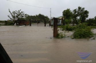 Flooding in Calawag, Magsaysay, Occidental Mindoro brought about by heavy rains dumped by Typhoon Quinta on Monday, Oct. 26, 2020 (Eagle News Service)