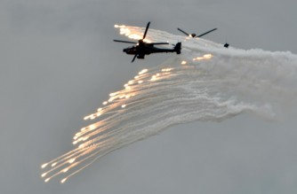 Two US-made AH-64E Apache attack helicopters release flares during Taiwan's annual Han Kuang military drills July 2020 (AFP photo)