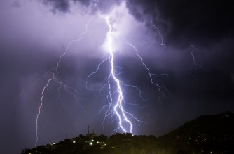 Lightning strikes during an electrical storm over Port-au-Prince on June 25, 2019. (Photo by CHANDAN KHANNA / AFP)