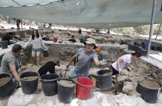 """Archaeologists take part in excavations at a site claimed to be the Biblical town of Ziklag near the southern Israeli city of Kiryat Gat on July 8, 2019. - Researchers in Israel said they have pinpointed the site of an ancient Philistine town mentioned in the biblical tale of David seeking refuge from the Israelite king Saul. Ziklag was a town under the rule of a Philistine king in nearby Gath after the ancient """"sea peoples"""" began arriving in the region in the 12th century BC, the researchers say. (Photo by MENAHEM KAHANA / AFP)"""