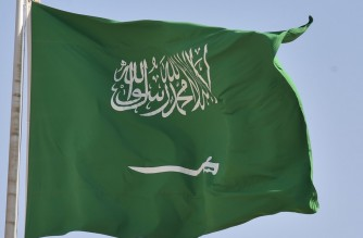 A picture taken on September 22, 2020 shows a Saudi national flag in Riyadh. (Photo by FAYEZ NURELDINE / AFP)