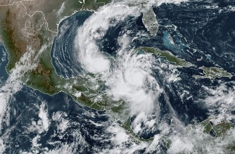 "This RAMMB/NOAA satellite image shows Hurricane Delta moving northwest in the Caribbean on October 6, 2020, at 15:20 UTC. - Hurricane Delta intensified rapidly into a Category 4 storm on October 6, 2020 and is set to slam into Mexico's Yucatan Peninsula early on October 7, 2020, the US National Hurricane Center said. Maximum sustained winds increased to 130 miles (215 kilometers) per hour, and the storm is ""forecast to be an extremely dangerous"" hurricane when it makes landfall, the center said. (Photo by Handout / RAMMB/NOAA/NESDIS / AFP) / RESTRICTED TO EDITORIAL USE - MANDATORY CREDIT ""AFP PHOTO / RAMMB/NOAA"" - NO MARKETING - NO ADVERTISING CAMPAIGNS - DISTRIBUTED AS A SERVICE TO CLIENTS"