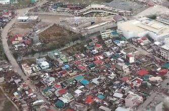 """This handout photo taken and received from the Philippine Coast Guard on November 2, 2020 shows an aerial view of damaged buildings on the island province of Catanduanes, in the aftermath of Typhoon Goni. (Photo by Handout / Philippine Coast Guard / AFP) / -----EDITORS NOTE --- RESTRICTED TO EDITORIAL USE - MANDATORY CREDIT """"AFP PHOTO / PHILIPPINE COAST GUARD """" - NO MARKETING - NO ADVERTISING CAMPAIGNS - DISTRIBUTED AS A SERVICE TO CLIENTS  - NO ARCHIVE"""