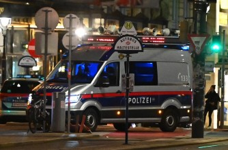 """Police cars stad in the center of Vienna on November 2, 2020, following a shooting. - Two people, including one attacker, have been killed in a shooting in central Vienna, police said late November 2, 2020. Vienna police said in a Twitter post there had been """"six different shooting locations"""" with """"one deceased person"""" and """"several injured"""", as well as """"one suspect shot and killed by police officers"""". (Photo by Joe Klamar / AFP)"""