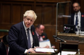 "A handout photograph released by the UK Parliament shows Britain's Prime Minister Boris Johnson attending the weekly Prime Minister's Questions (PMQs) in the House of Commons in London on November 4, 2020. - Prime Minister Boris Johnson insisted Wednesday that a looming new coronavirus lockdown for England would end ""automatically"" in four weeks, as he tried to placate party critics over the spiralling economic fallout. (Photo by JESSICA TAYLOR / various sources / AFP) / RESTRICTED TO EDITORIAL USE - MANDATORY CREDIT "" AFP PHOTO / UK PARLIAMENT / JESSICA TAYLOR "" - NO USE FOR ENTERTAINMENT, SATIRICAL, MARKETING OR ADVERTISING CAMPAIGNS - EDITORS NOTE THE IMAGE HAS BEEN DIGITALLY ALTERED AT SOURCE TO OBSCURE VISIBLE DOCUMENTS /"