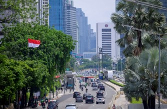 This picture taken on October 30, 2020 shows light traffic along a main road in central Jakarta after months of the government's policy implementing work from home. (Photo by BAY ISMOYO / AFP)