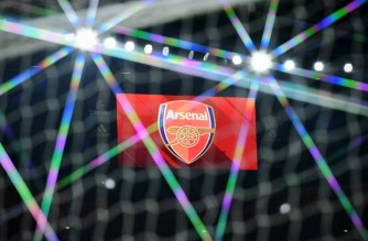 The electronic scoreboard displays the Arsenal club logo ahead of the UEFA Europa League Group B football match between Arsenal and Molde at the Emirates Stadium in London on November 5, 2020. (Photo by Glyn KIRK / AFP)