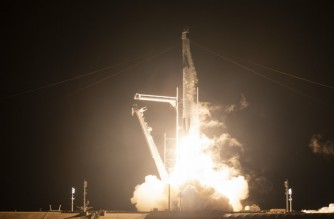 """This NASA handout photo shows a SpaceX Falcon 9 rocket carrying the company's Crew Dragon spacecraft being launched on NASA's SpaceX Crew-1 mission to the International Space Station with NASA astronauts Mike Hopkins, Victor Glover, Shannon Walker, and Japan Aerospace Exploration Agency astronaut Soichi Noguchi onboard, November 15, 2020, at NASA's Kennedy Space Center in Florida. - NASA's SpaceX Crew-1 mission is the first crew rotation mission of the SpaceX Crew Dragon spacecraft and Falcon 9 rocket to the International Space Station as part of the agency's Commercial Crew Program. NASA astronauts Mike Hopkins, Victor Glover, and Shannon Walker, and astronaut Soichi Noguchi of the Japan Aerospace Exploration Agency (JAXA) are scheduled to launch at 7:27 p.m. EST on November 15, from Launch Complex 39A at the Kennedy Space Center. (Photo by Joel KOWSKY / NASA / AFP) / RESTRICTED TO EDITORIAL USE - MANDATORY CREDIT """"AFP PHOTO /NASA/JOEL KOWSKY/HANDOUT """" - NO MARKETING - NO ADVERTISING CAMPAIGNS - DISTRIBUTED AS A SERVICE TO CLIENTS"""