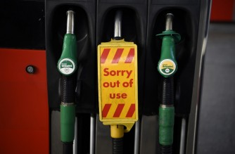 "A sign reading ""out of use"" is pictured on a diesel fuel pump, next to pumps for unleaded petrol at a petrol station in north London on November 18, 2020. - Britain will ban petrol and diesel vehicle sales from 2030 as part of a 10-point plan for a ""green industrial revolution"" to be unveiled Wednesday by Prime Minister Boris Johnson. (Photo by DANIEL LEAL-OLIVAS / AFP)"