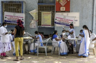 Medical staff register names of residents that came to undergo swab tests for the Covid-19 coronavirus at a primary health centre in Hyderabad on November 20, 2020, as India's coronavirus caseload passed nine million. (Photo by NOAH SEELAM / AFP)