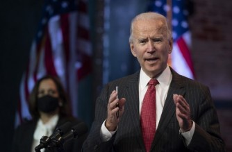 """(FILES) In this file photo US President-elect Joe Biden speaks after a meeting with governors in Wilmington, Delaware, on November 19, 2020. - US President-elect Joe Biden will name on November 24, 2020 the first picks to be part of his administration, his chief of staff said on November 22, 2020, declining to say what positions will be announced. """"You are going to see the first of the president-elect's cabinet picks on Tuesday of this week,"""" Biden's chief of staff Ron Klain told ABC. """"You'll have to wait for president-elect to say that himself on Tuesday."""" (Photo by JIM WATSON / AFP)"""