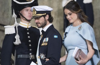 Prince Carl Philip of Sweden and Princess Sofia leave the christening of Prince Oscar at the Royal Chapel in Stockholm on May 27, 2016. (Photo by JONATHAN NACKSTRAND / AFP)