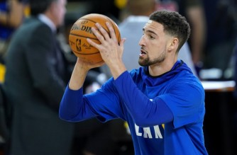 OAKLAND, CALIFORNIA - JUNE 13: Klay Thompson #11 of the Golden State Warriors warms up prior to Game Six of the 2019 NBA Finals against the Toronto Raptors at ORACLE Arena on June 13, 2019 in Oakland, California. NOTE TO USER: User expressly acknowledges and agrees that, by downloading and or using this photograph, User is consenting to the terms and conditions of the Getty Images License Agreement.   Thearon W. Henderson/Getty Images/AFP