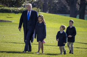 WASHINGTON, DC - NOVEMBER 29: U.S. President Donald Trump, followed by his grandchildren, Arabella Kushner, Theodore Kushner, and Joseph Kushner walk on the south lawn of the White House on November 29, 2020 in Washington, DC. President Trump spent the weekend at Camp David and at Trump National Golf Club in Sterling, Virginia.   Tasos Katopodis/Getty Images/AFP