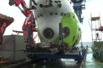 China showed footage of its new manned submersible parked at the bottom of the ocean Friday, a week after it first sent people to the deepest known place on Earth (Screenshot of CCTV video provided by Agence France Presse)