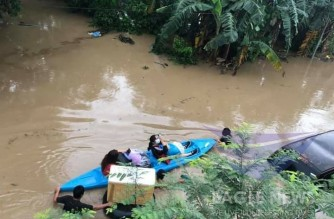 A boat travelling a flooded area in Cagayan province after typhoon Ulysses submerged many areas in the province.  (Eagle News Service)