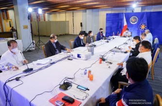 President Rodrigo Roa Duterte presides over a meeting with the Inter-Agency Task Force on the Emerging Infectious Diseases (IATF-EID) core members prior to his talk to the people at the Arcadia Active Lifestyle Center in Davao City on November 23, 2020. JOEY DALUMPINES/ PRESIDENTIAL PHOTO