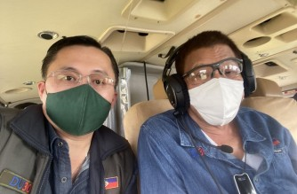 """President Rodrigo Duterte conducts an aerial inspection on Monday, Nov. 2, of areas in the Bicol region severely hit by Super Typhoon Rolly (Goni).  With him is Senator Christopher """"Bong"""" Go. (Photo courtesy Sen. Bong Go)"""
