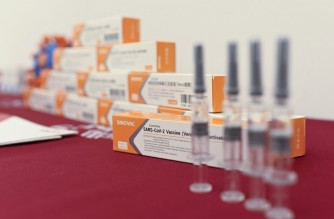 Sinovac Biotech vaccines, one of 11 Chinese companies approved to carry out clinical trials of potential coronavirus vaccines, are displayed at a press conference during a media tour of a new factory built to produce Covid-19 coronavirus vaccines, in Beijing on September 24, 2020. (Photo by WANG ZHAO / AFP)