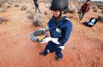 """This handout photograph taken and released by the Japan Aerospace Exploration Agency (JAXA) on December 6, 2020 shows recovery operations of the re-entry capsule, carrying samples collected from a distant asteroid after being dropped off by Japanese space probe Hayabusa-2, following its landing in South Australia. (Photo by Handout / JAXA / AFP) / RESTRICTED TO EDITORIAL USE - MANDATORY CREDIT """"AFP PHOTO / JAXA"""" - NO MARKETING NO ADVERTISING CAMPAIGNS - DISTRIBUTED AS A SERVICE TO CLIENTS"""