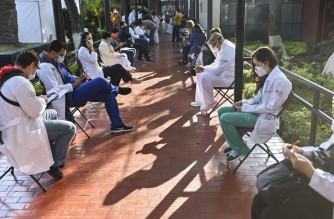 Medical personnel are seen after receiving the Pfizer/BioNTech Covid-19 vaccine jab, at the General Hospital in Mexico City, on December 24, 2020. - Mexico started a mass coronavirus vaccination program on Thursday with a nurse first to be shown receiving the jab in the country with one of the world's highest Covid-19 death tolls. (Photo by PEDRO PARDO / AFP)