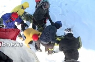 """A screen grab from footage broadcast on Iranian state tv Irib on December 26, 2020 shows a rescue operation after eight climbers were found dead dead and at least seven others missing due to avalanches north of Tehran. (Photo by - / IRIB NEWS AGENCY / AFP) / RESTRICTED TO EDITORIAL USE - MANDATORY CREDIT - AFP PHOTO / HO / IRIB"""" NO MARKETING NO ADVERTISING CAMPAIGNS - DISTRIBUTED AS A SERVICE TO CLIENTS FROM ALTERNATIVE SOURCES, AFP IS NOT RESPONSIBLE FOR ANY DIGITAL ALTERATIONS TO THE PICTURE'S EDITORIAL CONTENT, DATE AND LOCATION WHICH CANNOT BE INDEPENDENTLY VERIFIED  - NO RESALE - NO ACCESS ISRAEL MEDIA/PERSIAN LANGUAGE TV STATIONS/ OUTSIDE IRAN/ STRICTLY NI ACCESS BBC PERSIAN/ VOA PERSIAN/ MANOTO-1 TV/ IRAN INTERNATIONAL /"""