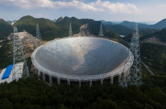 This picture taken on September 24, 2016 shows the Five-hundred-metre Aperture Spherical Radio Telescope (FAST) in Pingtang, in southwestern China's Guizhou province. - Humanity's best bet at detecting aliens is a giant silver Chinese dish the size of 30 football fields -- one that simultaneously showcases Beijing's abilities to deploy cutting-edge technologies and ignore objectors' rights as it seeks global prominence. (Photo by STR / AFP) / China OUT