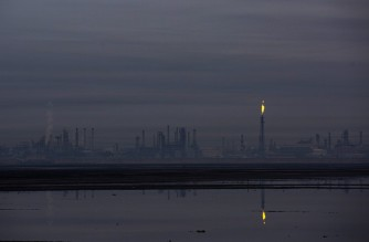 A picture taken on December 23, 2020, shows the South Refineries Company in the southern Iraqi city of Basra. (Photo by Hussein FALEH / AFP)