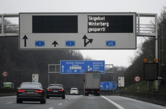 A sign reading 'Winterberg ski area closed' is seen at the A1 motorway in Hagen, western Germany, on January 4, 2021 amid the ongoing novel coronavirus / COVID-19 pandemic. - German Chancellor Angela Merkel and state leaders are expected Tuesday, January 5, 2021 to extend a partial lockdown in Europe's top economy as coronavirus deaths continue to mount despite tough restrictions in the run-up to the holidays. (Photo by Ina FASSBENDER / AFP)