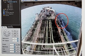 "A CCTV footage of the Hankuk Chemi, a South Korean-flagged oil tanker, is displayed on a screen as a boat of Iran's Revolutionary Guards is seen in red circle on the screen at the tanker's owner company DM Shipping, in Busan on January 4, 2021. - South Korea's foreign ministry on January 4 demanded the ""early release"" of an oil tanker seized by Iran in Gulf waters for breaking maritime environmental laws. (Photo by - / YONHAP / AFP) / - South Korea OUT / REPUBLIC OF KOREA OUT  NO ARCHIVES  RESTRICTED TO SUBSCRIPTION USE"