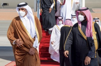 """A handout picture provided by the Saudi Royal Palace on January 5, 2021, shows Crown Prince Mohammed bin Salman (R) welcoming Emir of Qatar Tamim bin Hamad Al-Thani (L) upon his arrival in the city of al-Ula in northwestern Saudi Arabia for the 41st Gulf Cooperation Council (GCC) summit. - Saudi Arabia will reopen its borders and airspace to Qatar, US and Kuwaiti officials said, a major step towards ending a diplomatic rift that has seen Riyadh lead an alliance isolating Doha. The bombshell announcement came on the eve of GCC annual summit in the northwestern Saudi Arabian city of Al-Ula, where the dispute was already set to top the agenda. (Photo by BANDAR AL-JALOUD / Saudi Royal Palace / AFP) / RESTRICTED TO EDITORIAL USE - MANDATORY CREDIT """"AFP PHOTO / SAUDI ROYAL PALACE / BANDAR AL-JALOUD"""" - NO MARKETING - NO ADVERTISING CAMPAIGNS - DISTRIBUTED AS A SERVICE TO CLIENTS"""