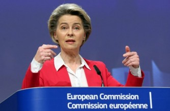 European Commission President Ursula Von Der Leyen gives a presser on vaccine strategy on January 8, 2021 in Brussels. (Photo by François WALSCHAERTS / POOL / AFP)