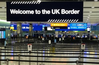 (FILES) In this file photo taken on December 31, 2020, a UK border sign welcomes passengers on arrival at Heathrow airport in west London. - Britain's Transport Secretary Grant Shapps set out new rules which, from next week, will require passengers arriving in England by boat, train or plane - including UK nationals - to take a test up to 72 hours before leaving the country of departure.  Failure to comply will lead to an immediate £500 fine. (Photo by Ben FATHERS / AFP)
