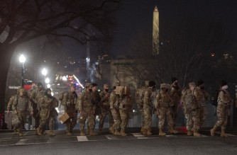 Members of the US National Guard deploy around the US Capitol on January 12, 2021 in Washington, DC. - The Pentagon is deploying as many as 15,000 National Guard troops to protect Biden's inauguration on January 20, amid fears of new violence. (Photo by ANDREW CABALLERO-REYNOLDS / AFP)