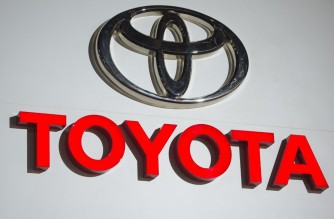 (FILES) In this file photo taken on January 09, 2017, the logo for Toyota during the 2017 North American International Auto Show in Detroit, Michigan. - Toyota will pay $180 million to settle charges it failed to comply with rules mandating that auto companies report problems with vehicle emissions to authorities, the US Department of Justice said on January 14, 2021. (Photo by SAUL LOEB / AFP)