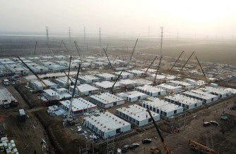 "This aerial photo taken on January 16, 2021 shows the under-construction centralized quarantine facilities, where people at risk of contracting the Covid-19 coronavirus are to be taken into quarantine in Shijiazhuang, in northern Hebei province after the province declared an ""emergency state"". (Photo by STR / CNS / AFP) / China OUT"