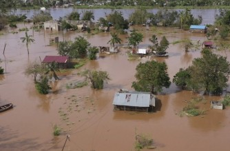 """This video grab made from hand out aerial video footage taken by UNICEF on January 24, 2021 shows widespread flooding in the Buzi area of Mozambique after the landfall of Cyclone Eloise. - Tropical Cyclone Eloise made landfall around 2:30am on January 23, with wind speeds of 160 kilometres per hour. The worst of the storm's winds are over, but flooding remains a major threat in the days to come. With many key communications systems down, UNICEF emergency teams are on the ground assessing the situation to design quick and efficient relief response. The immediate identified needs are shelter, food, water, medical attention and the protection of children from abuse and exploitation, UNICEF said. (Photo by Bruno Pedro / UNICEF / AFP) / RESTRICTED TO EDITORIAL USE - MANDATORY CREDIT """"AFP PHOTO /UNICEF/Bruno Pedro """" - NO MARKETING - NO ADVERTISING CAMPAIGNS - DISTRIBUTED AS A SERVICE TO CLIENTS"""