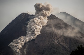 Mount Merapi, Indonesia's most active volcano, spews rocks and gas for another day in Yogyakarta on January 27, 2021. (Photo by Agung Supriyanto / AFP)