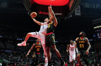 ATLANTA, GA - JANUARY 14: Devin Booker #1 of the Phoenix Suns drives to the basket against the Atlanta Hawks on January 14, 2020 at State Farm Arena in Atlanta, Georgia. NOTE TO USER: User expressly acknowledges and agrees that, by downloading and/or using this Photograph, user is consenting to the terms and conditions of the Getty Images License Agreement. Mandatory Copyright Notice: Copyright 2020 NBAE   Scott Cunningham/NBAE via Getty Images/AFP