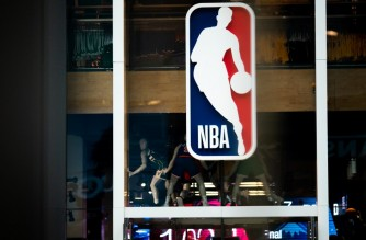 NEW YORK, NY - MARCH 12: An NBA logo is shown at the 5th Avenue NBA store on March 12, 2020 in New York City. The National Basketball Association said they would suspend all games after player Rudy Gobert of the Utah Jazz reportedly tested positive for the Coronavirus (COVID-19).   Jeenah Moon/Getty Images/AFP