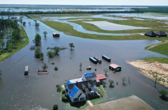 IOWA, LOUISIANA - OCTOBER 10: In this aerial view from a drone, a model home is surrounded by flood waters from Hurricane Delta in an area still recovering from Hurricane Laura on October 10, 2020 in Iowa, Louisiana. Hurricane Delta made landfall as a Category 2 storm in Louisiana initially leaving some 300,000 customers without power.   Mario Tama/Getty Images/AFP