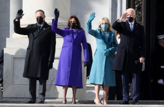 WASHINGTON, DC - JANUARY 20: (L-R) Doug Emhoff, U.S. Vice President-elect Kamala Harris, Jill Biden and President-elect Joe Biden wave as they arrive on the East Front of the U.S. Capitol for the inauguration on January 20, 2021 in Washington, DC. During today's inauguration ceremony Joe Biden becomes the 46th president of the United States.   Joe Raedle/Getty Images/AFP