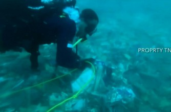 Divers from the Indonesian Navy find debris suspected to be wreckage of the crashed passenger jet. A Sriwijaya Air Boeing 737 with 62 people on board crashed into the Java sea shortly after take-off on Saturday. (Screenshot of AFPTV video/Courtesy Agence France Presse)