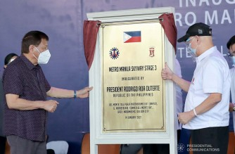 President Rodrigo Roa Duterte leads the unveiling of the marker of the Metro Manila Skyway Stage 3 (MMSS-3) Project during the inauguration ceremony at the Del Monte Toll Plaza in Quezon City on January 14, 2021. ALFRED FRIAS/ PRESIDENTIAL PHOTO